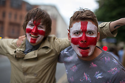 © Licensed to London News Pictures . 14/06/2014 .  Manchester , UK . L-R Chris Stokes (23 from Manchester) and Jamie Bullivant (23 from Manchester) in Manchester City Centre this evening (Saturday 14th June 2014) as England prepare to play Italy in their first match of the 2014 World Cup , in Brazil . Photo credit : Joel Goodman/LNP