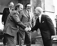 Brian Faulkner, chief minister, N Ireland Executive (right), meets the newly-appointed Minister of State for N Ireland, Stan Orme. Also in the photo is the Secretary of State for N Ireland, Merlyn Rees. Taken; 6th March 1974. They are pictured on the steps of Stormont Castle. 197403060022b.<br /> <br /> Copyright Image from Victor Patterson, 54 Dorchester Park, <br /> Belfast, UK, BT9 6RJ<br /> <br /> t1: +44 28 9066 1296 (from Rep of Ireland 048 9066 1296)<br /> t2: +44 28 9002 2446 (from Rep of Ireland 048 9002 2446)<br /> m: +44 7802 353836<br /> <br /> e1: victorpatterson@me.com<br /> e2: victorpatterson@gmail.com<br /> www.victorpatterson.com<br /> <br /> Please see my Terms and Conditions of Use at www.victorpatterson.com. It is IMPORTANT that you familiarise yourself with them.<br /> <br /> Images used on the Internet must be visibly watermarked i.e. © Victor Patterson<br /> within the body of the image and copyright metadata must not be deleted. Images <br /> used on the Internet have a size restriction of 4kbs and will be chargeable at current<br />  NUJ rates unless agreed otherwise.<br /> <br /> This image is only available for the use of the download recipient i.e. television station, newspaper, magazine, book publisher, etc, and must not be passed on to any third <br /> party. It is also downloaded on condition that each and every usage is notified within 7 days to victorpatterson@me.com<br /> <br /> The right of Victor Patterson to be identified as the author is asserted in accordance with The Copyright Designs And Patents Act (1988). All moral rights are asserted.