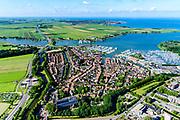 Nederland, Noord-Holland, Monnickendam, 13-06-2017; overzicht van Monnickendam met jachthaven aan de Gouwzee, IJsselmeer aan de horizon.<br /> Monnickendam with marina.<br /> <br /> luchtfoto (toeslag op standard tarieven);<br /> aerial photo (additional fee required);<br /> copyright foto/photo Siebe Swart