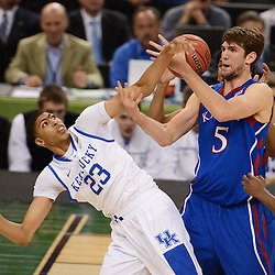 Apr 2, 2012; New Orleans, LA, USA; Kansas Jayhawks center Jeff Withey (5) and Kentucky Wildcats forward Anthony Davis (23) battle for the loose ball during the first half in the finals of the 2012 NCAA men's basketball Final Four at the Mercedes-Benz Superdome. Mandatory Credit: Derick E. Hingle-USA TODAY SPORTS