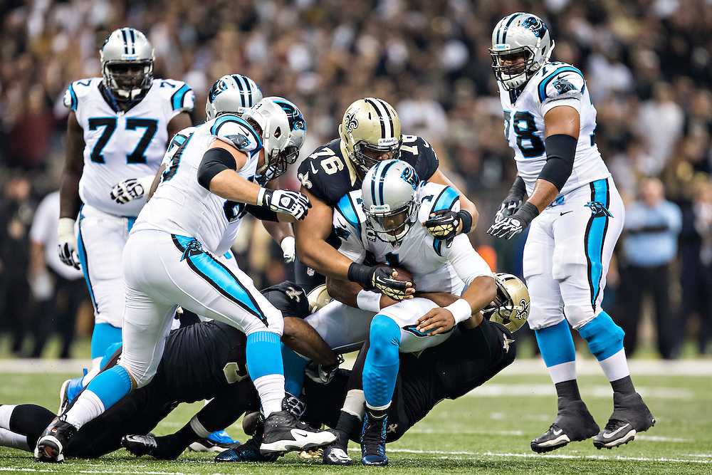 NEW ORLEANS, LA - DECEMBER 8:  Cam Newton #1 of the Carolina Panthers is sacked by Akiem Hicks #76 and Cameron Jordan #94 of the New Orleans Saints at Mercedes-Benz Superdome on December 8, 2013 in New Orleans, Louisiana.  The Saints defeated the Panthers 31-13.  (Photo by Wesley Hitt/Getty Images) *** Local Caption *** Cam Newton; Akiem Hicks; Cameron Jordan