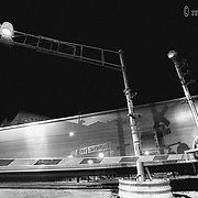 The motion of trains combined with a long camera shutter opening at dusk