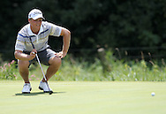 Marc Gladson of Cedar Rapids lines up his shot on the 2nd hole during the first round of the Greater Cedar Rapids Open held at Hunters Ridge Golf Course in Marion on Friday, July 22, 2011.