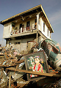 January 6, 2004 Banda Aceh, Indonesia--  The portrait of childs sits mong the remains of homes in downtonwn Banda Aceh, Indonesia  after the Dec. 26 tsunami.