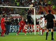n/z.: bramkarz Jerzy Dudek (nr1-Liverpool) broni podczas meczu finalowego Ligi Mistrzow FC Liverpool (czerwone) - AC Milan (biale) 3:3 karne 3:2 , liga mistrzow , final sezon 2004/2005 , pilka nozna , Turcja , Stambul , 25-05-2005 , fot.: Adam Nurkiewicz / mediasport..goalkeeper Jerzy Dudek (nr1-Liverpool) saves during final Champions League soccer match in Istambul. May 25, 2005 ; FC Liverpool (red) - AC Milan (white) 3:3 penalty 3:2 ; Champions League , final season 2004/2005 , football , Turkey , Istambul ( Photo by Adam Nurkiewicz / mediasport )