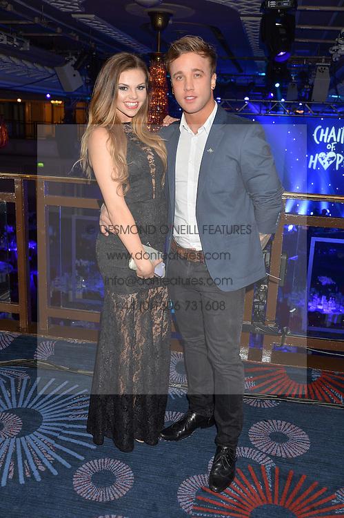 GABRIELLA RYAN and SAM CALLAHAN at the Chain of Hope Gala Ball held at The Grosvenor House Hotel, Park Lane, London on 18th November 2016.