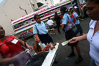 A woman buys some food in the pedestrian shopping zone of Panama City on Tuesday, September 4, 2007. (Photo/Scott Dalton).