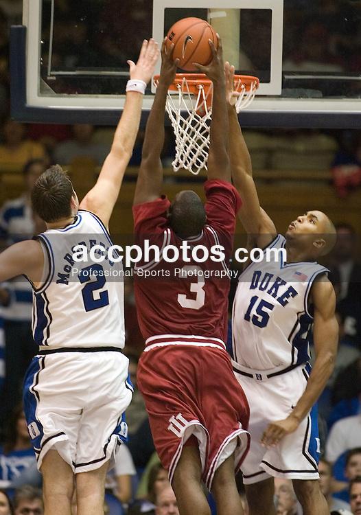 Nov. 28, 2006; Durham, NC, USA; Duke Blue Devils forward (2) Josh McRoberts and guard (15) Gerald Henderson defend Indiana Hoosiers forward (3) D.J. White in a 51-54 Duke win at Cameron Indoor Stadium in Durham.
