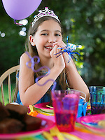Portrait of young girl (10-12) at birthday party