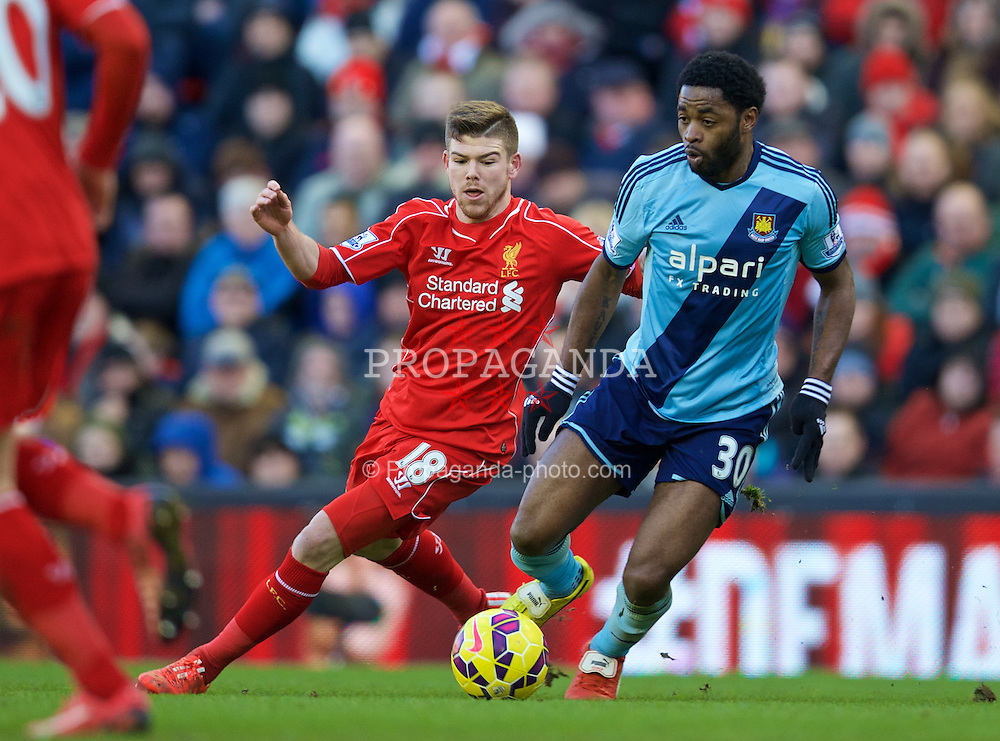LIVERPOOL, ENGLAND - Saturday, January 31, 2015: Liverpool's Alberto Moreno in action against West Ham United's Alex Song during the Premier League match at Anfield. (Pic by David Rawcliffe/Propaganda)