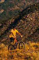 A mountain biker riding on a trail, Albuquerque, New Mexico USA
