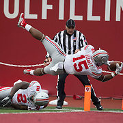 3 October 2015: Ohio State Buckeyes running back Ezekiel Elliott (15) dives over the goal line for a touchdown  during the game between the Indiana Hoosiers and the Ohio State Buckeyes  at Memorial Stadium in Bloomington, Indiana. (Photo by Khris Hale/Icon Sportswire)