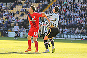 York City forward Reece Thompson has a hold of Notts County defender Haydn Hollis shirt during the Sky Bet League 2 match between Notts County and York City at Meadow Lane, Nottingham, England on 26 September 2015. Photo by Simon Davies.