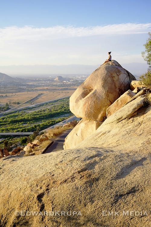 Woman taking in the late day sun on Mount Rubidoux in Riverside California.