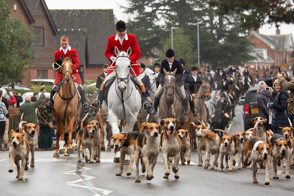 © Licensed to London News Pictures. 26/12/2018. Market Bosworth, UK. Boxing Day Hunt meet. The traditional Boxing Day Hunt meet took part in Market Bosworth, Leicestershire, earlier today. Riders of all ages took part in the parade. Meeting in the market square, they visited a near by care home taking their hounds to meet residents. The Hunt formed up in pairs and rode through the town centre passing huge Boxing Day crowds that had come to see the spectacle. Photo credit: Dave Warren/LNP