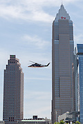 GOP Presidential nominee Donald Trump flies past the city skyline as he arrives by private helicopter welcomed by Vice Presidential nominee Indiana Governor Mike Pence and his children for the Republican National Convention July 20, 2016 in Cleveland, Ohio. Trump flew into the lakeside airport by his private jet and then by helicopter for a grand arrival.