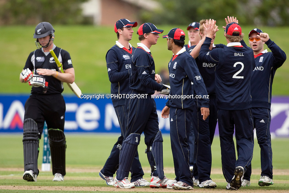 The England team celebrate the wicket of Jimmy Neesham. New Zealand v England, U19 Cricket World Cup SL 7th-8th Place, Village Green, QEII, Christchurch, Tuesday 26 January 2010. Photo : Joseph Johnson/PHOTOSPORT