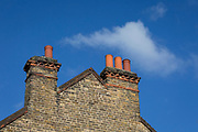 Victorian-era chimney pots and blue skies above south London in Herne Hill, on 10th February 2019, in London, England.