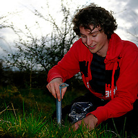 In the calcareous grassland areas located in the centre of Wytham woods, Chris Jeffs takes soil cores to study the effects of soil microbes on the germination of seed banks and diversity of resultant seedling communities