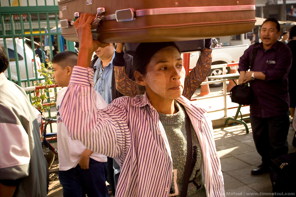 """Thai immigration and customs officials screen people for drugs, trafficking victims, and other contraband at the Thai/Myanmar (Burma) border in Mae Sai, northern Thailand, on 15 January, 2007. A second, larger crossing is opening nearby to handle an expected increase of cross-border traffic as the """"Asian Highway"""" is built to facilitate transport in the Greater Mekong Sub-Region, from China to Thailand, Laos, Cambodia, Myanmar (Burma), and Vietnam. Historically plagued by human trafficking of the area's poorer hill tribe children, according to local NGO workers the border crossing in Mae Sai is likely to grow in importance as a transit point for trafficking victims as the new transportation infrastructure eases the movement of people from poorer countries like Laos and Myanmar (Burma)."""