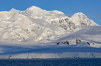 Glacial covered Branant Island in Gerlache Strait, Antarctica.