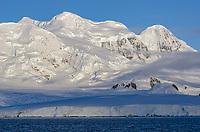 Glacial covered Branant Island in Gerlache Strait, Antarctica.
