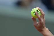 Ballboy holds the official ball in his hand during men's single first round while Day First during The French Open 2014 at Roland Garros Tennis Club in Paris, France.<br /> <br /> France, Paris, May 25, 2014<br /> <br /> Picture also available in RAW (NEF) or TIFF format on special request.<br /> <br /> For editorial use only. Any commercial or promotional use requires permission.<br /> <br /> Mandatory credit:<br /> Photo by © Adam Nurkiewicz / Mediasport
