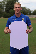 AFC Wimbledon midfielder Mitchell (Mitch) Pinnock (11) holding Fifa sign during the AFC Wimbledon 2018/19 official photocall at the Kings Sports Ground, New Malden, United Kingdom on 31 July 2018. Picture by Matthew Redman.