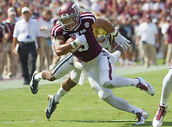 Texas A&M wide receiver Christian Kirk (3) breaks an attempted tackle by UCLA defensive back Tahaan Goodman (21) for positive yards during the second quarter of an NCAA college football game Saturday, Sept. 3, 2016, in College Station, Texas. Texas A&M won 31-24 in over time. (AP Photo/Sam Craft)