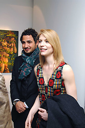 ZAC POSEN and CLAIRE DAINES at an exhibition of paintings by artist Rene Richard at the Scream Gallery, Bruton Street, London on 3rd April 2008.<br />