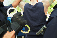 Police officers in action close-up of handcuffs