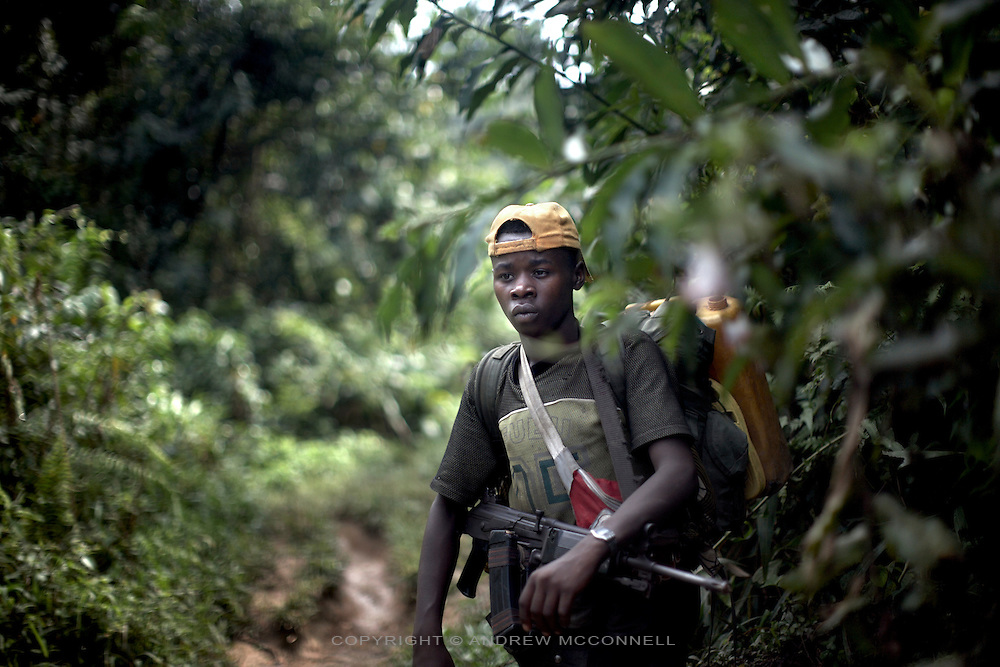 A young FDLR soldier in the jungles of North Kivu, DRC, on Sunday, March. 16, 2008..The FDLR comprises Hutu extremists who fled Rwanda after their involvement in the 1994 genocide, as well as Hutu members of the former Rwandan army and a mix of displaced Rwandan Hutus. Numbering approximately 10,000, they have lived in the jungles of DRC for the past 14 years and in that time have resisted repeated calls for disarmament and repatriation..