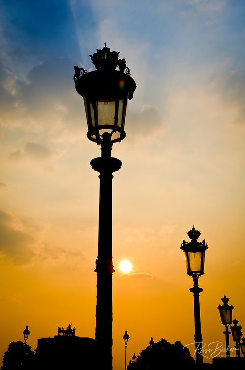 Street lamps at sunset, Louvre Museum, Paris, France