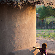 Young girl outside of a Venda hut in Hamakuya. Venda village in Limpopo Province, South Africa.