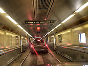 ROAD TRIP: Photographers Georgie Gillard and Rick Findler drove 1,973 miles and through nine countries for a friends wedding in Lake Garda, Northern Italy. Armed only with an iPhone and pushed for time, they decided to document their journey through the windscreen of their car.<br /> Pictured: Inside the Channel Tunnel. Calais, France.