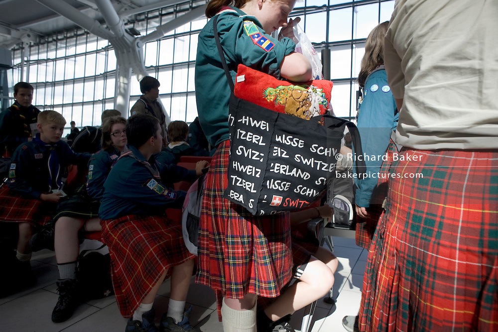 Scottish scout troupe passengers await their flight in departures at Heathrow's Terminal 5.