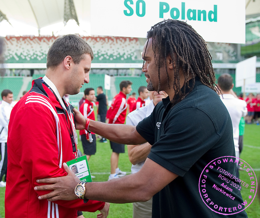 (R) Christian Karembeu - Special Olympics Ambassador  former French soccer player and current scout for Arsenal Football Club gives medals to Polish team during the 2013 Special Olympics European Unified Football Tournament in Warsaw, Poland.<br /> <br /> Poland, Warsaw, June 08, 2012<br /> <br /> Picture also available in RAW (NEF) or TIFF format on special request.<br /> <br /> For editorial use only. Any commercial or promotional use requires permission.<br /> <br /> <br /> Mandatory credit:<br /> Photo by © Adam Nurkiewicz / Mediasport