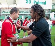 (R) Christian Karembeu - Special Olympics Ambassador  former French soccer player and current scout for Arsenal Football Club gives medals to Polish team during the 2013 Special Olympics European Unified Football Tournament in Warsaw, Poland.<br /> <br /> Poland, Warsaw, June 08, 2012<br /> <br /> Picture also available in RAW (NEF) or TIFF format on special request.<br /> <br /> For editorial use only. Any commercial or promotional use requires permission.<br /> <br /> <br /> Mandatory credit:<br /> Photo by &copy; Adam Nurkiewicz / Mediasport
