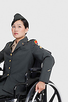 Female US military officer in wheelchair over gray backgrounds