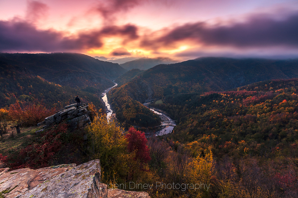 Picturesque river meander in a mountain with colorful autumn forest