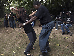 March 9, 2016 - Charlesville, Liberia - JENNY DESMOND dances at a farewell party given by LCR (Liberian Chimpanzee Rescue) a project of Humane Society of the United States, to save research chimpanzees abandoned by New York Blood Center in Liberia which stopped all funding for food and water when they retired the chimps formerly used for experimentation.  Humane Society of the United States and New York Blood Center came to an agreement recently in May 2017 after years of discussion about the care of research chimps.  A team from HSUS attends the party after coming to observe efforts in March 2016. NYBC also refused to pay their original caregivers who had worked for the center and were abandoned as well.  The caregivers initially used their own meager finances to continue feeding them.  Over 60 chimps now live on six islands serving as a sanctuary run by Jenny and James Desmond to improve the dire situation in which the chimpanzees were left to die. (Credit Image: © Carol Guzy via ZUMA Wire)