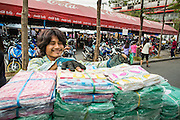 16 FEBRUARY 2013 - BANGKOK, THAILAND:    A porter stacks merchandise before taking it to a market stall in Chatuchak Weekend Market in Bangkok. It is reportedly the largest market in Thailand and the world's largest weekend market. Frequently called J.J., it covers more than 35 acres and contains upwards of 5,000 stalls.       PHOTO BY JACK KURTZ