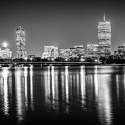 Boston skyline at night black and white picture with Back Bay buildings, Harvard Bridge, Charles River, John Hancock Tower, and Prudential Tower. Boston Massachusetts is a major city in the Eastern United States of America.