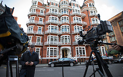 © Licensed to London News Pictures. 04/02/2016. London, UK. A journalist films the Ecuadorian Embassy where Wikileaks founder Julian Assange is living.  A United Nations panel is due to decide if Julian Assange has been kept in 'unlawful detention' during his stay at the embassy for the past three-and-a-half-years. Photo credit: Peter Macdiarmid/LNP