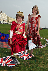BRIGHTON, UK  29/04/2011. The Royal Wedding of HRH Prince William to Kate Middleton.  Emily (4) and Abigal (8) dressed up for a small party on Brighton sea front. Photo credit should read JULIE EDWARDS/LNP. Please see special instructions. © under license to London News Pictures