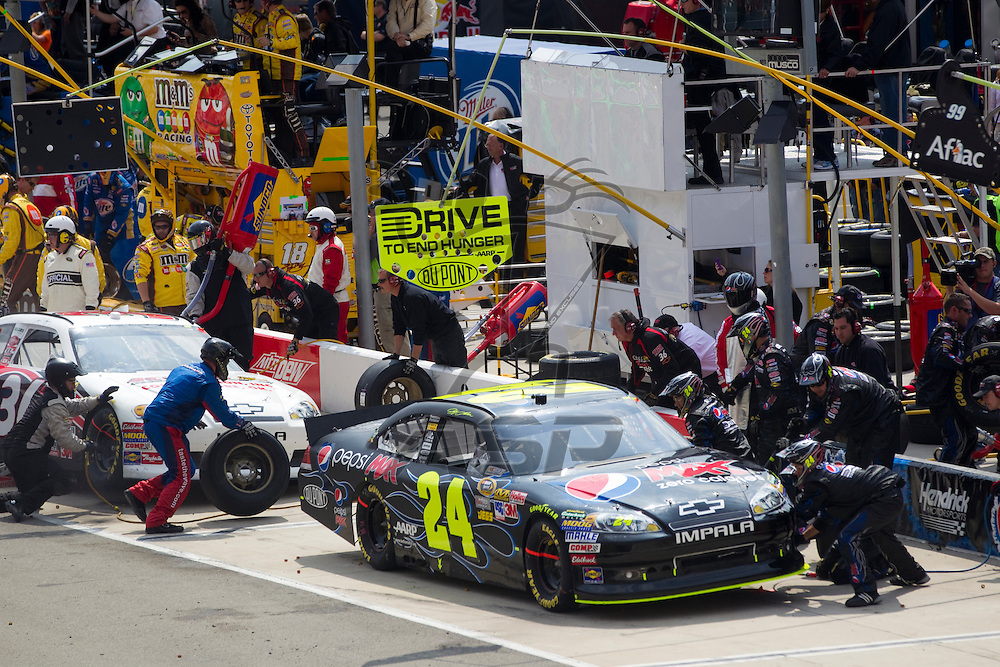 BRISTOL, TN - MAR 20, 2011:  Jeff Gordon (24) comes in for a pit stop during the Jeff Byrd 500 race at the Bristol Motor Speedway in Bristol, TN.