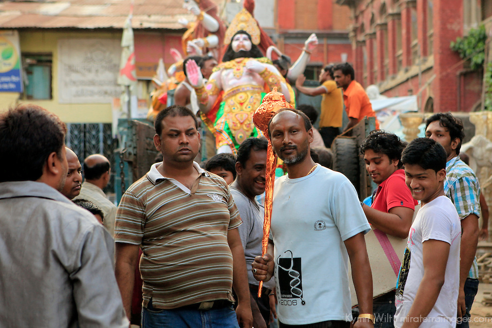 Asia, India, Calcutta. Scene from the potter's village of Kumartuli in Calcutta, as a finished clay diety is raised for procession.