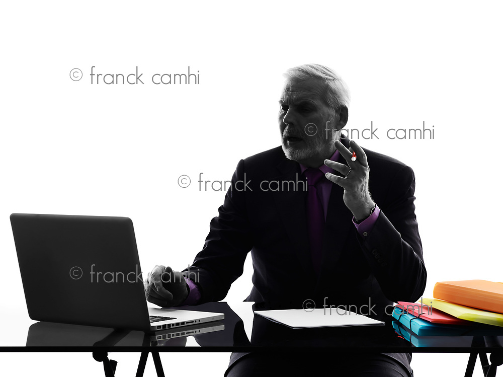One Caucasian Senior Business Man computing laptop Silhouette White Background