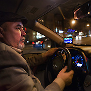 "WASHINGTON, DC - APR 4:  UberX driver Ali Jaghori picks up a customer in Logan Circle, April 4, 2014, in Washington, DC. Jaghori, a former Washington Flyer driver, now drives soley for UberX. Thousands of local car owners have signed up in recent months to drive with one of the ""ride-share"" operators that use smartphone apps to link people needing rides with car owners willing to give them, for a price. (Photo by Evelyn Hockstein/For The Washington Post)"
