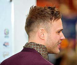 © under license to London News Pictures. 04/03/11. Olly Murs. Have a  Heart Appeal Day 2011, in aid of Children's Hospices UK, at Heart Radio in Liecester Square, London . Photo credit should read Alan Roxborough/LNP